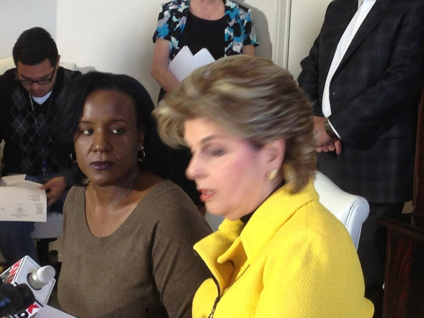At a news conference with attorney Gloria Allred, Ebony Jones, left, alleges that her late mother was badly treated while living in a building owned by Donald and Shelly Sterling.