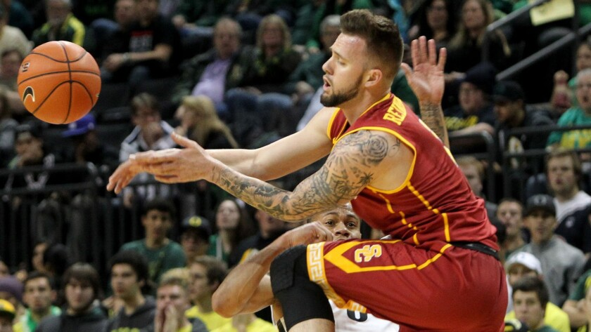 USC's Katin Reinhardt runs into Oregon's Joseph Young while making a pass during the Trojans' loss on Jan. 22.