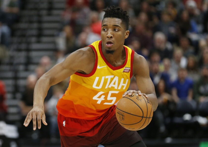 FILE- In this Feb. 9, 2018, file photo, Utah Jazz guard Donovan Mitchell (45) drives up court in the second half during an NBA basketball game against the Charlotte Hornets in Salt Lake City. Mitchell and Philadelphia 76ers' Ben Simmons, the leading rookie of the year candidates, will play together Friday, Feb. 16, when the NBA's best first- and second-year players compete in the Rising Stars in Los Angeles to tip off All-Star weekend. (AP Photo/Rick Bowmer, File)