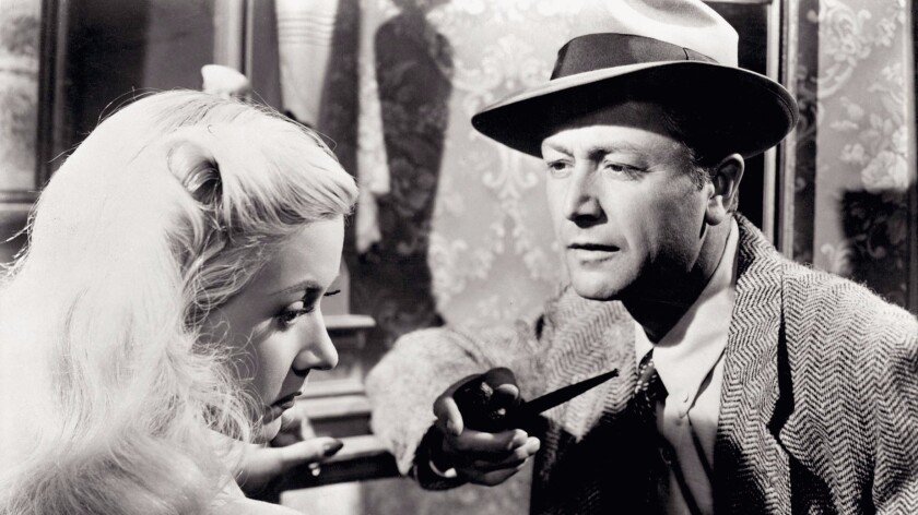 """Gloria Grahame and Robert Young in """"Crossfire."""""""