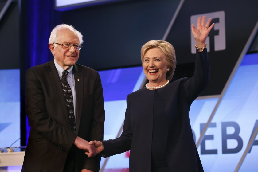 Democratic primary candidates Bernie Sanders and Hillary Clinton shake hands before the start of a debate hosted by the Miami-Dade College on March 9.