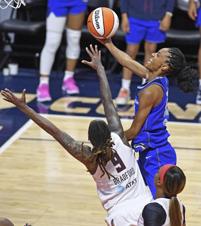 Connecticut Sun forward DeWanna Bonner, top right, shoots over Atlanta Dream forward Crystal Bradford (9) during a WNBA basketball game Friday, July 9, 2021, in Uncasville, Conn. (Sean D. Elliot/The Day via AP)
