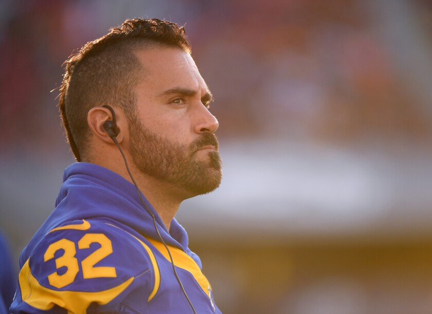 Rams safety Eric Weddle stands on the sideline during a preseason game against the Denver Broncos on Aug. 24.