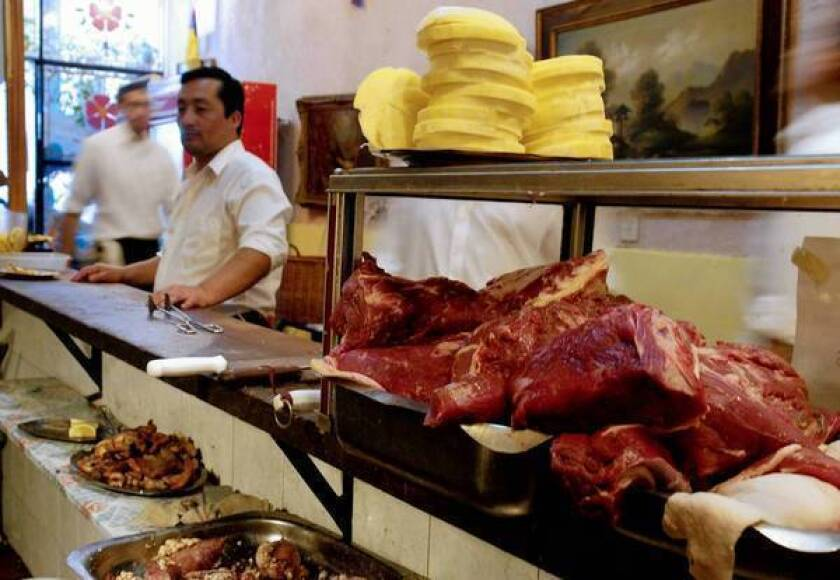 Raw meat waits to be cooked at El Desnivel in Buenos Aires. Despite the proliferation of steakhouses in Buenos Aires, vegetarian food can be food.