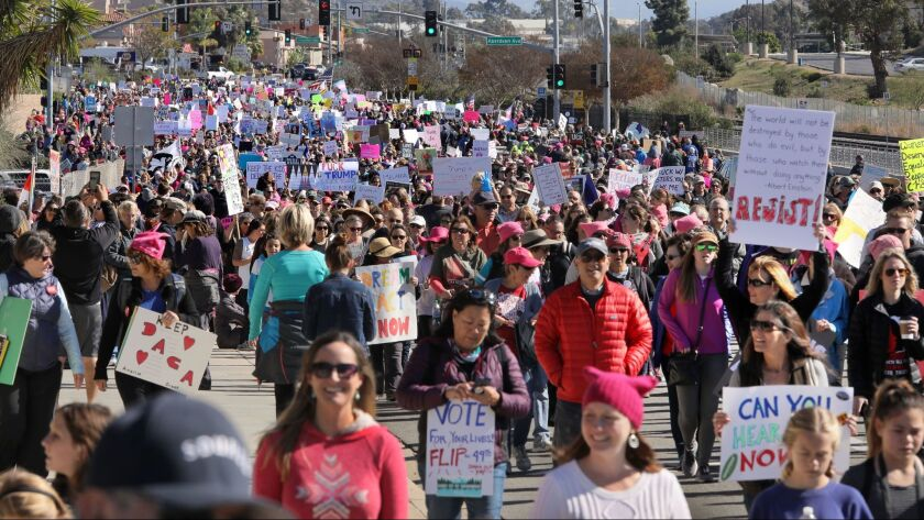 Thousands march on Mission Road in the North County Women's March in this view looking east that began and ended at Palomar College.
