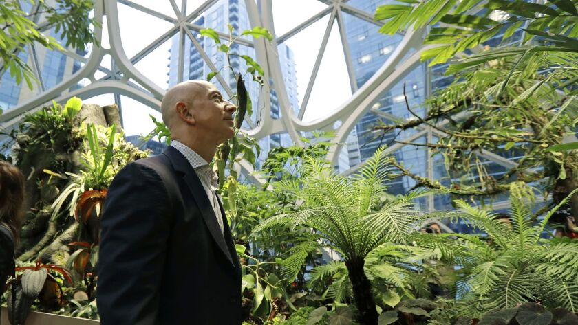 Jeff Bezos, the CEO and founder of Amazon, takes a walking tour of the Amazon Spheres in Seattle.