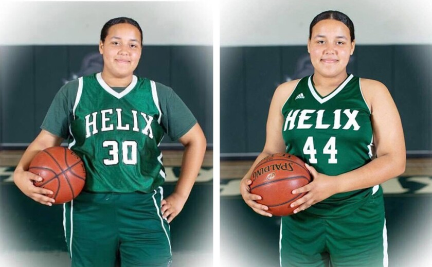 In a photos provided by a relative, Leah Christopher (left) and her twin sister, Caira, were photographed during Helix High School basketball team photos.