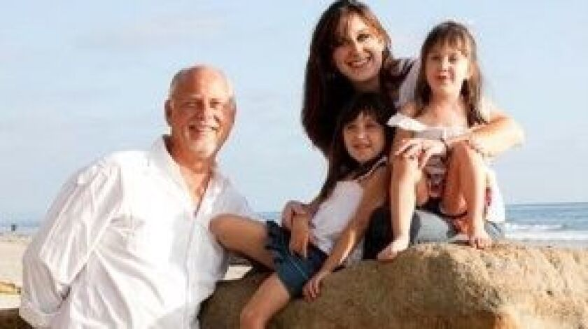 Roger Mullins stand with his daughter Ashley and his two granddaughters.