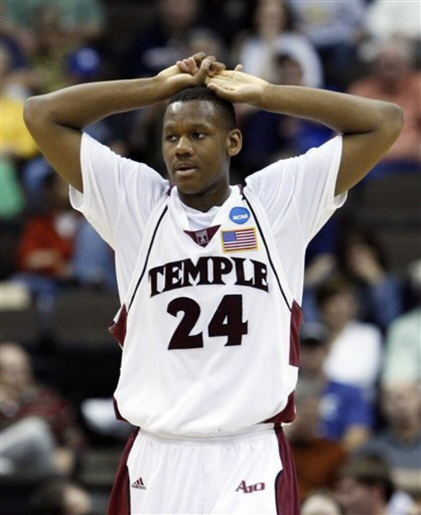 Temple's Lavoy Allen (24) reacts as his team falls behind Cornell during the second half during an NCAA first-round college basketball game in Jacksonville, Fla., Friday, March 19, 2010.  (AP Photo/Wilfredo Lee)