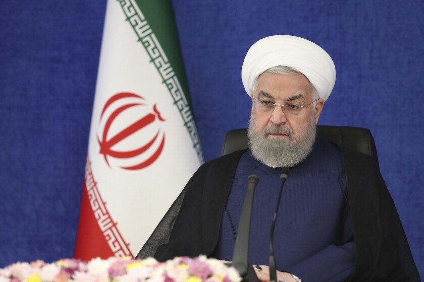In this photo released by the official website of the office of the Iranian Presidency, President Hassan Rouhani attends a meeting of National Task Force for Fighting Coronavirus in Tehran, Iran, Saturday, July 3, 2021. President Rouhani said Saturday that Iran may face another wave of coronavirus infections, as health officials warned of the spread of the more infectious delta variant of the virus. (Iranian Presidency Office via AP)