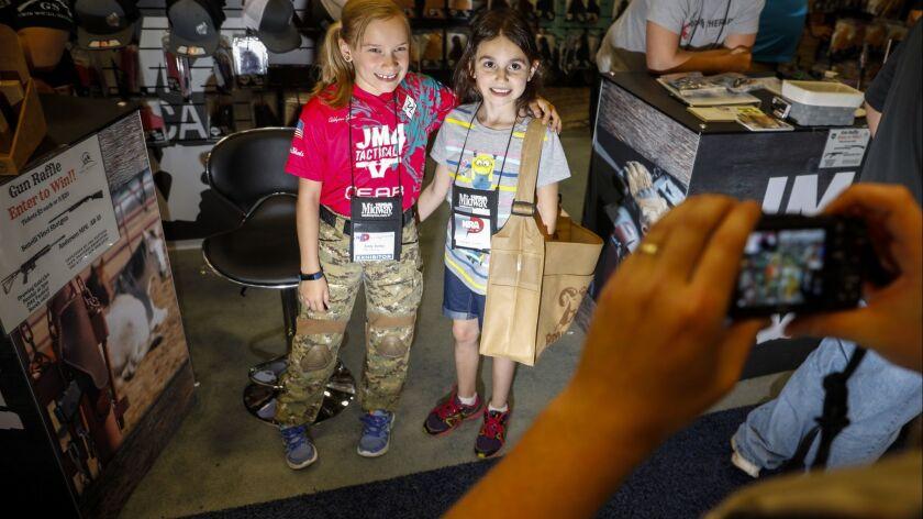 "DALLAS,TX --SATURDAY, MAY 05, 2018--Addyson ""Alpha Addy"" Soltau,9, left, takes a photo with Gracie P"