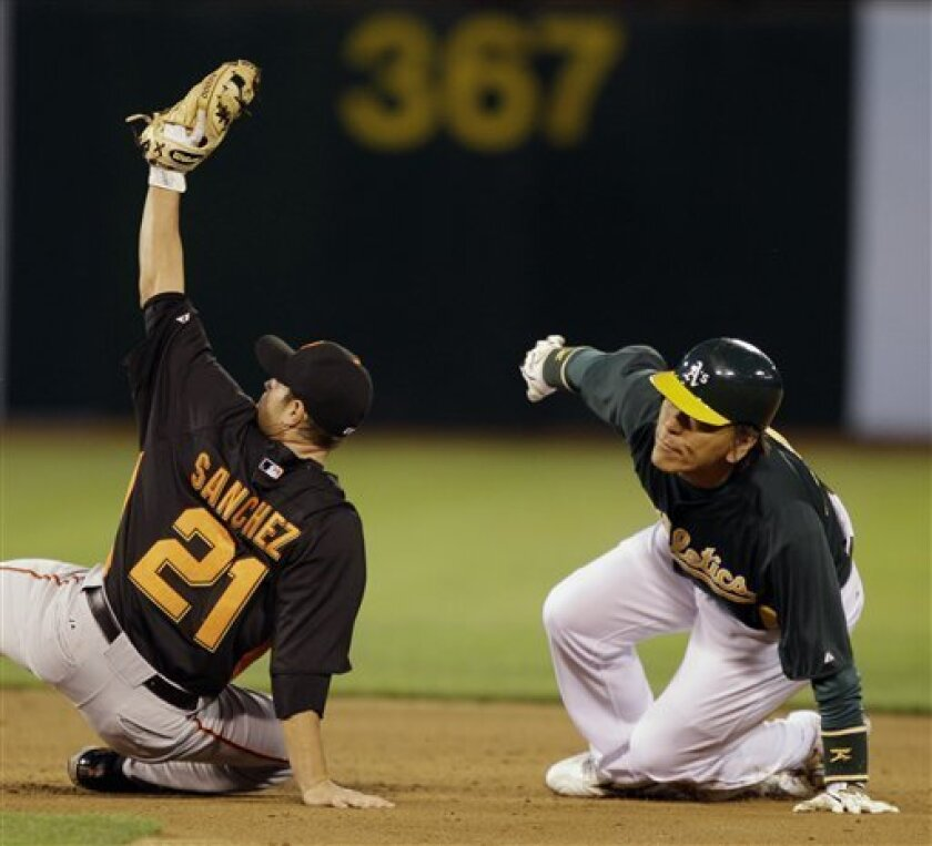 San Francisco Giants second baseman Freddy Sanchez (21) tags out Oakland Athletics' Hideki Matsui as Matsui tried to steal second base during the second inning of a spring training baseball game in Oakland, Calif., Tuesday, March 29, 2011. (AP Photo/Marcio Jose Sanchez)