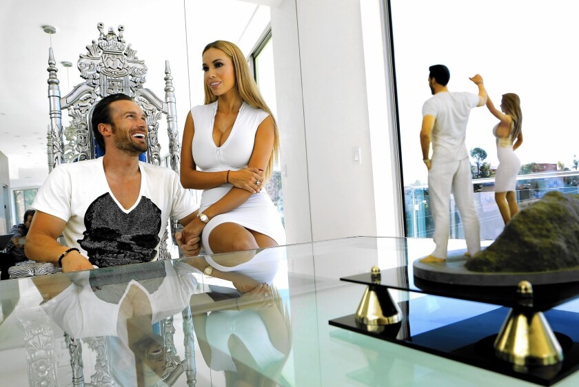Bastian Yotta and his wife, Maria, inside the 10-bedroom, 12,000-square-foot mansion they rent in the Hollywood Dell neighborhood.