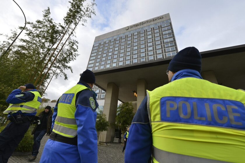 Swiss police are shown Thursday outside the Geneva's Intercontinental hotel, site of closed-door nuclear talks on Iran's nuclear program.