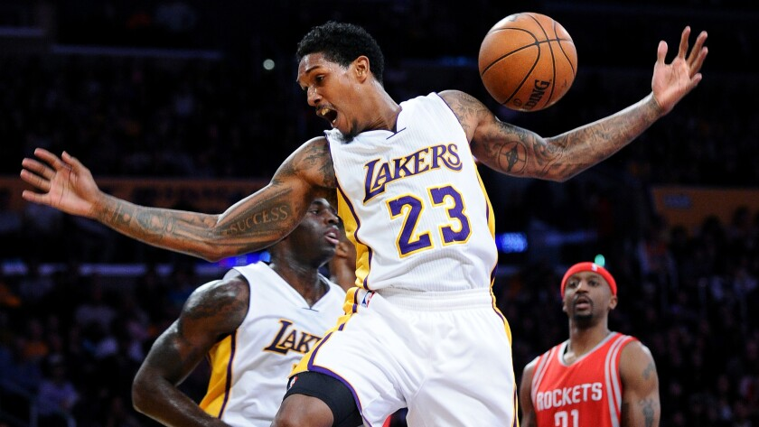 """Lakers guard Lou Williams, seen after making a dunk last season, says, """"I understand police have a hard job to do,"""" but he's troubled by the use of """"lethal force"""" over """"childish crimes."""""""