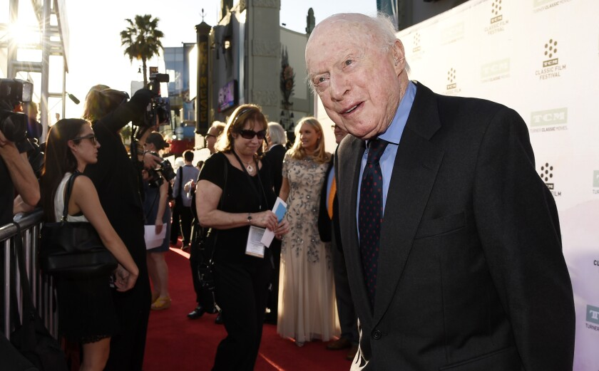 """FILE - Norman Lloyd poses before a 50th anniversary screening of the film """"The Sound of Music"""" at the opening night gala of the TCM Classic Film Festival on March 26, 2015, in Los Angeles. Lloyd, the distinguished stage and screen actor known for his role as a kindly doctor on TV's """"St. Elsewhere,"""" has died at 106. Manager Marion Rosenberg said the actor died Tuesday, May 11, 2021, at his home in the Brentwood neighborhood of Los Angeles. (Photo by Chris Pizzello/Invision/AP, File)"""