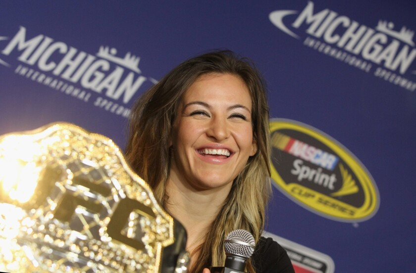 Tate prepares for UFC title defense, with Rousey looming large