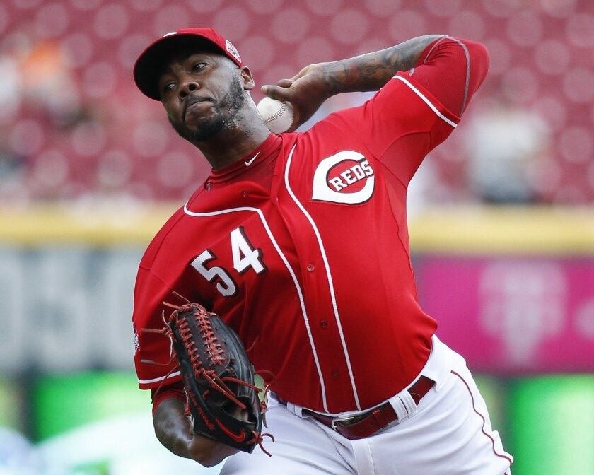 FILE - In this Sept. 7, 2015, file photo, Cincinnati Reds relief pitcher Aroldis Chapman throws in the ninth inning of a baseball game against the Pittsburgh Pirates in Cincinnati. Chapman and the New York Yankees have agreed to a one-year contract worth $11,325,000, avoiding salary arbitration. (A