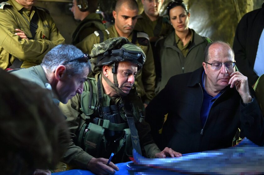 Israeli Defense Minister Moshe Yaalon, right, is among the Israeli officials condemning the Iran nuclear deal as a threat for Israel.