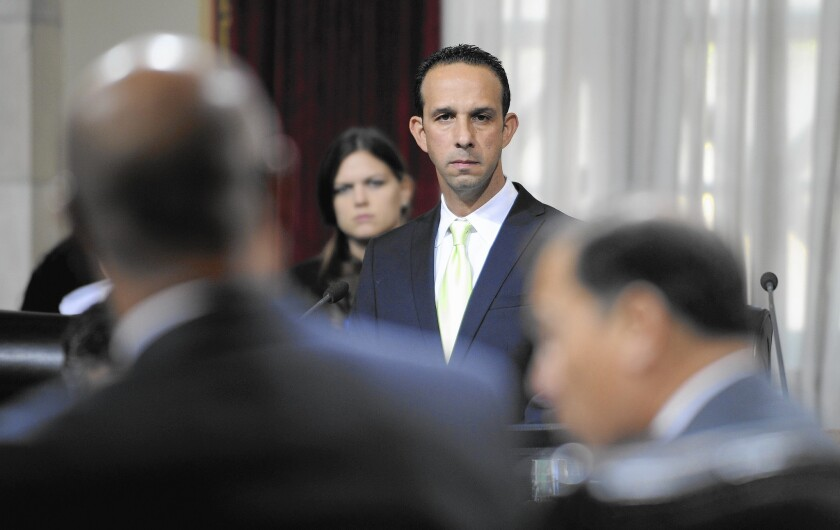 L.A. Councilman Mitchell Englander, who is running for L.A. County supervisor, listens during a Dec. 1, 2015, meeting about the gas leak near Porter Ranch.
