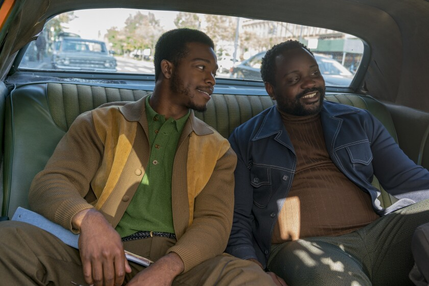 """Stephan James, left, as Fonny and Brian Tyree Henry as Daniel in Barry Jenkins' """"If Beale Street Could Talk."""""""