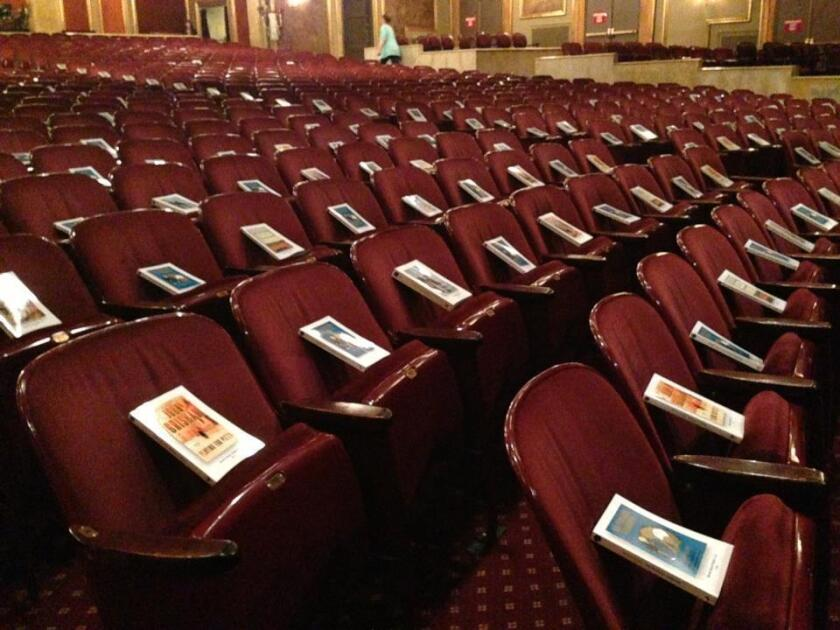 Books await theatergoers at a production of Annie in New York City during World Book Night, in April 2013.