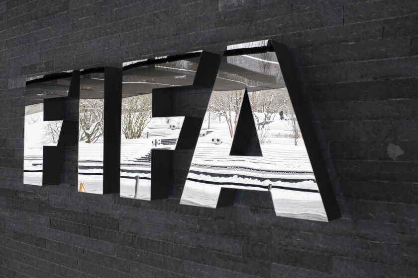 FILE - In this Tuesday, Jan. 10. 2017 file photo, the FIFA logo is pictured at the Home of FIFA in Zurich, Switzerland. FIFA is facing an escalating backlash across soccer over the decision to ignore concerns of clubs and leagues and squeeze more World Cup qualifiers into September and overlook coronavirus-related quarantine requirements. Premier League clubs were holding talks on Tuesday, Aug, 24, 2021 about forming a unified position to block players going to countries on England's red list which also features several South American countries, including Argentina, Brazil, Chile and Peru. (Ennio Leanza/Keystone via AP, file)