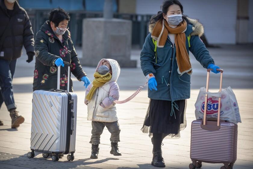 Travelers in Beijing.