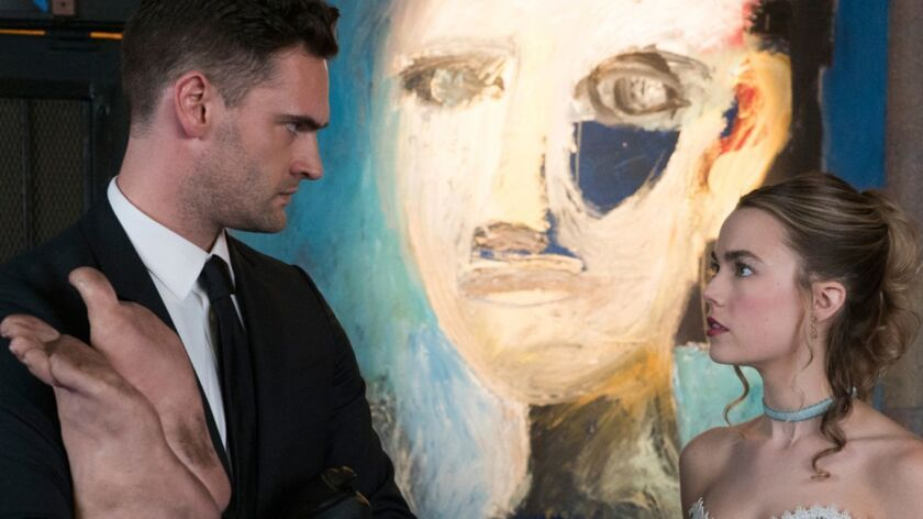 """Tom Bateman and Rebecca Rittenhouse in """"The Body,"""" the first installation of Hulu's monthly horror anthology """"Into the Dark."""""""