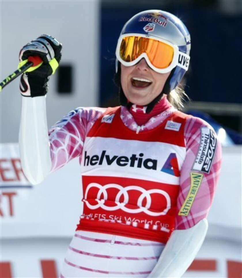 First placed Lindsey Vonn, USA, celebrates in the finish area at the women's alpine ski World Cup Super-G race in St. Moritz, Switzerland, Sunday, Jan. 31, 2010. (AP Photo/Keystone, Karl Mathis)