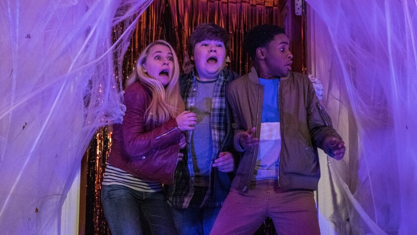 "Madison Iseman, from left, Jeremy Ray Taylor and Caleel Harris in the movie ""Goosebumps 2: Haunted Halloween."""