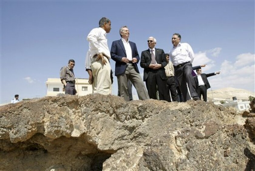 Former British Prime Minister and international Middle East envoy Tony Blair, third left, visits the West Bank village of Aloja near Jericho, Wednesday, May 6, 2009. Blair said Tuesday that the Obama administration and international negotiators are drafting a new strategy for Israeli-Palestinian peace talks and expect to unveil it within six weeks.(AP Photo/Nasser Ishtayeh)