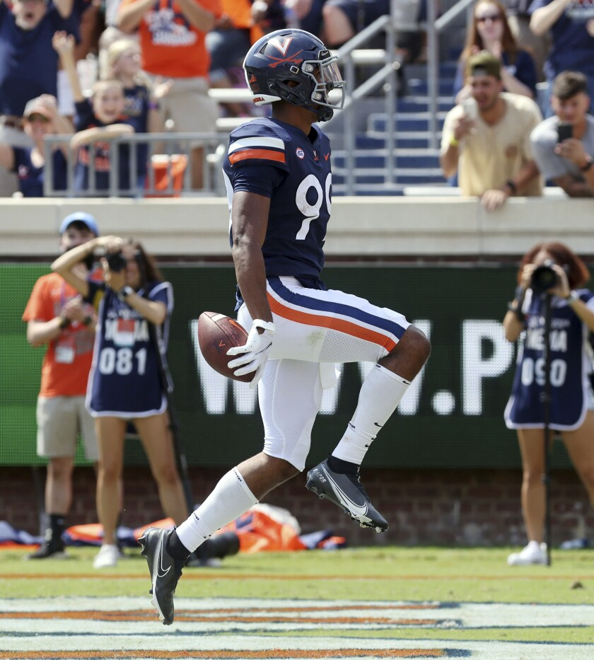Virginia's Keytaon Thompson (99) celebrates a touchdown against Illinois during an NCAA college football game, Saturday, Sept. 11, 2021, at Scott Stadium in Charlottesville, Va. (Andrew Shurtleff/The Daily Progress via AP)