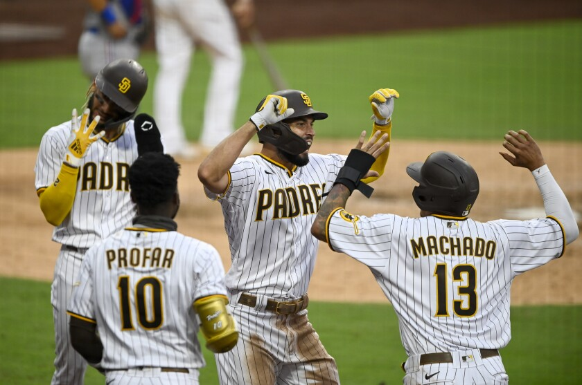Fernando Tatis Jr. held up four fingers to signify four straight games with a grand slam by Padres after Eric Hosmer hit one.