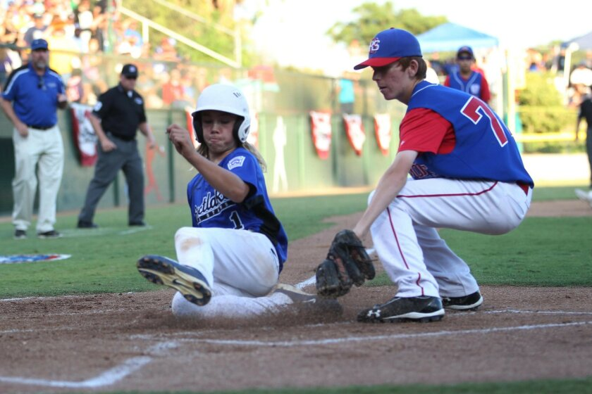 Eastlake's Micah Pietila-Wiggs scores on a passed ball in the second inning as Northern California pitcher Sean Lee attempts to make the tag.