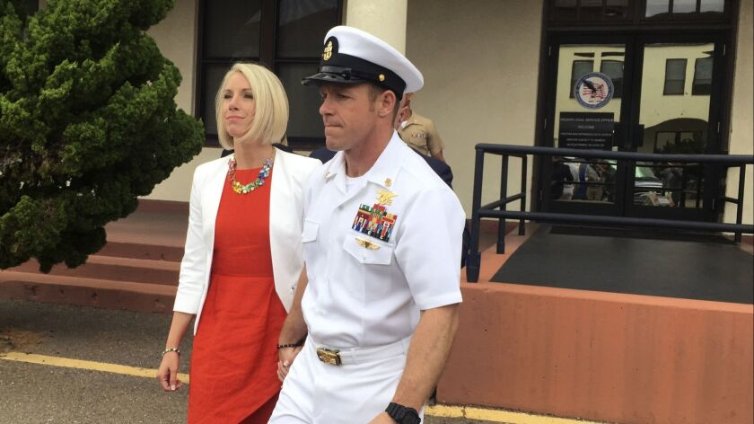 Navy Special Operations Chief Edward Gallagher leaves a military courtroom with his wife, Andrea Gallagher, last week after a judge freed him from custody pending trial.
