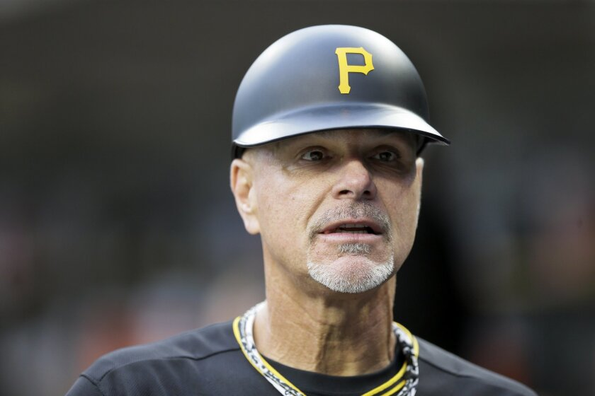 Pirates third base coach Rick Sofield is seen in the dugout during the first inning of a baseball game against the Detroit Tigers, Tuesday, June 30, 2015, in Detroit.
