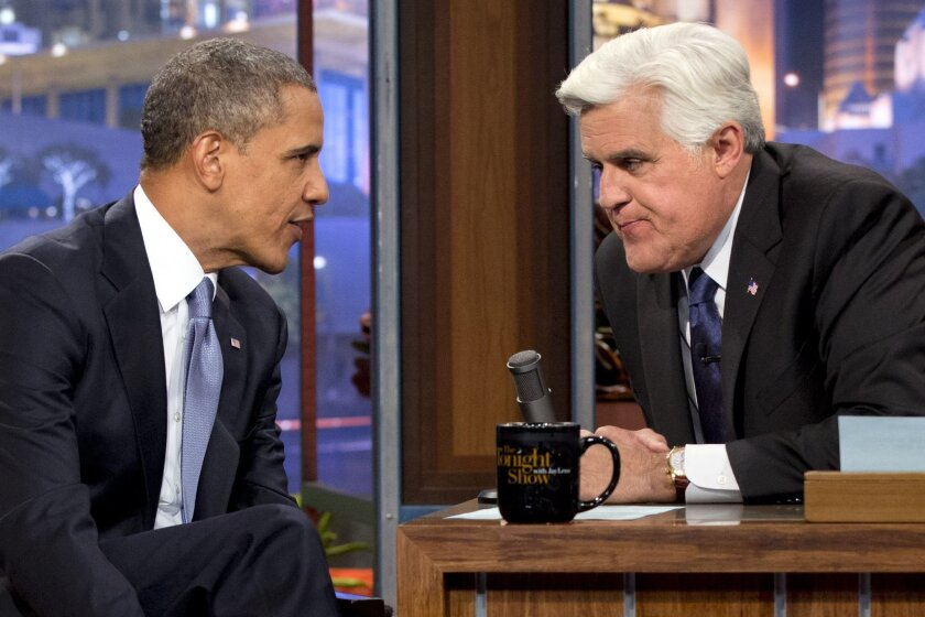 "FILE - This Aug. 6, 2013 file photo shows President Barack Obama talking with Jay Leno during a commercial break during the taping of his appearance on ""The Tonight Show with Jay Leno"" in Los Angeles. President Barack Obama is wishing Leno well as he prepares to say farewell to ""The Tonight Show"" on Thursday. Obama spokesman Jay Carney says Obama is a Leno fan and has enjoyed his many appearances with the late-night comedian in his Burbank, Calif., studio. (AP Photo/Jacquelyn Martin, File)"