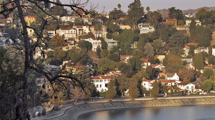 PRETTIER PICTURE: Silver Lake glistens on a morning last fall. Officials plan to clean debris and fill the lake by June.