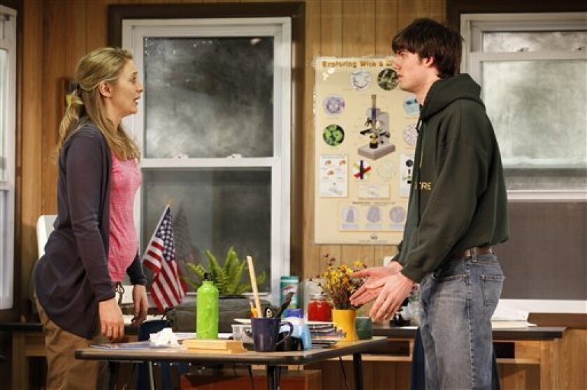 """In this theater image released by Bruce Cohen Group, Heidi Schreck, left, and Justin Kruger are shown in a scene from """"How the World Began,"""" a Women's Project Theater production performing off-Broadway at the Peter Jay Sharp Theater in New York. (AP Photo/Bruce Cohen Group, Carol Rosegg)"""