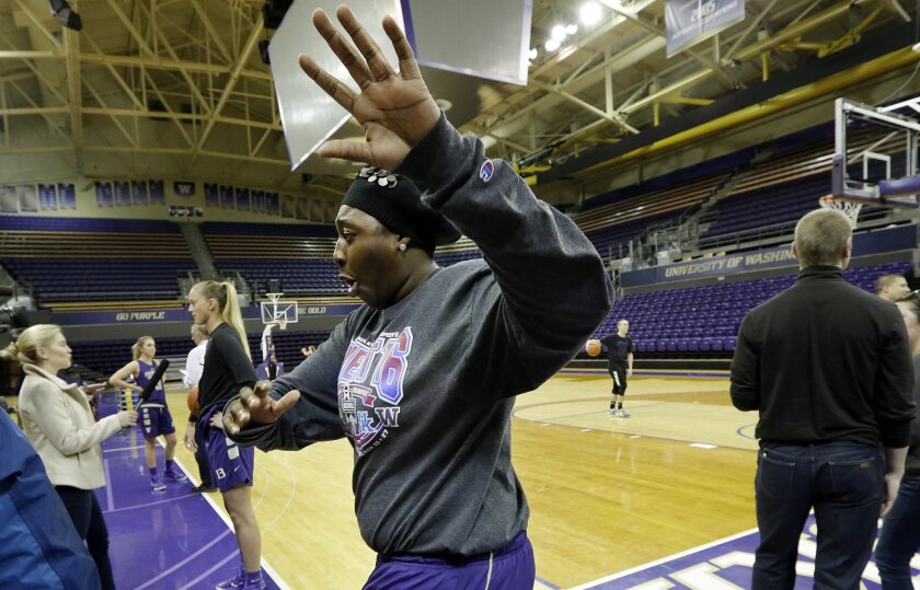 Washington's Chantel Osahor playfully reacts to the presence of media members before a basketball practice Tuesday, March 29, 2016, in Seattle. Washington plays Syracuse in a Final Four game Sunday. (AP Photo/Elaine Thompson)