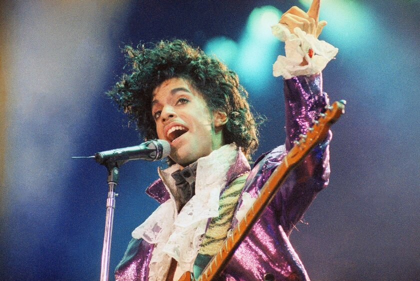 """FILE - In this Feb. 18, 1985 file photo, Prince performs at the Forum in Inglewood, Calif. Prince, widely acclaimed as one of the most inventive and influential musicians of his era with hits including """"Little Red Corvette,"""" ''Let's Go Crazy"""" and """"When Doves Cry,"""" was found dead at his home on Thur"""