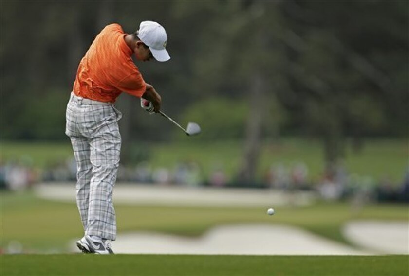Amateur Guan Tianlang, of China, hits off the second fairway during the second round of the Masters golf tournament Friday, April 12, 2013, in Augusta, Ga. (AP Photo/Charlie Riedel)