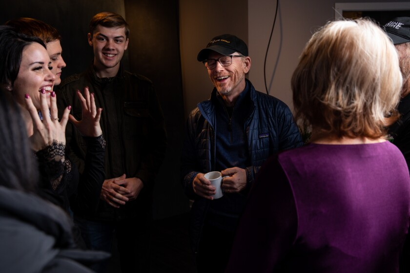 """Director Ron Howard from the documentary, """"Rebuilding Paradise,"""" talks with the films subjects after they're photographed in the L.A. Times Studio at Sundance."""