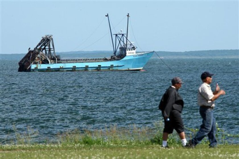 The ESS Pursuit is tied up about a half-mile off Fort Taber to undergo inspection from the Coast Guard, New Bedford, Mass., Monday, June 7, 2010. The U.S. Coast Guard says a Massachusetts-based fishing boat dredging for clams off New York has pulled up 10 canisters, including one that broke open an