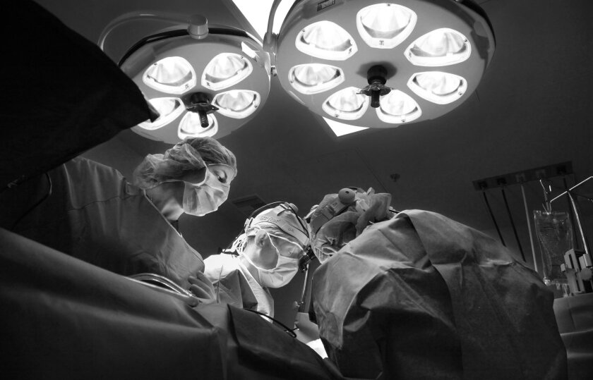 Plastic surgeons, doctors Gil and Zol Kryger at the Kryger Institute of Plastic Surgery in Thousand Oaks, performed top surgery on Sam in July. Top surgery is the removal of breast tissue, a crucial step in Sam's transition to becoming a male.
