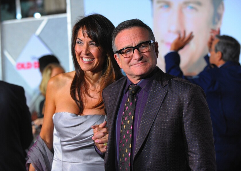 """This morning, I lost my husband and my best friend, while the world lost one of its most beloved artists and beautiful human beings. I am utterly heartbroken,"" Susan Schneider Williams said after the death of Robin Williams last August."