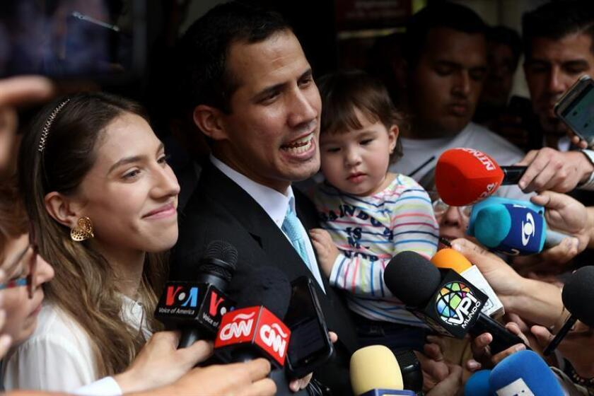 Venezuela National Assembly speaker Juan Guaido is accompany by wife Fabiana Rosales and the couple's daughter while talking to reporters outside their home in Caracas on Thursday, Jan. 31. EFE- EPA/Cristian Hernandez