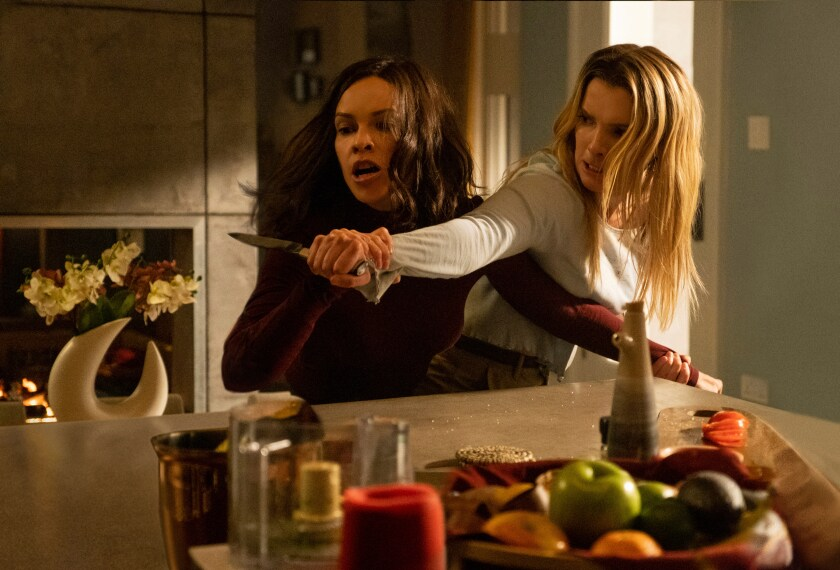 """Hillary Swank and Betty Gilpin in """"The Hunt"""""""