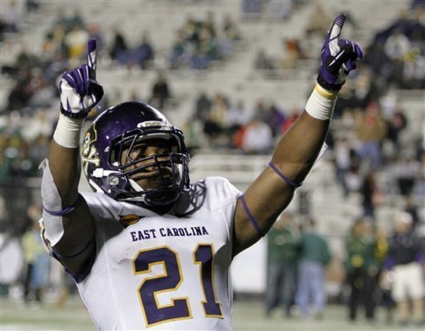 FILE - This Oct. 20, 2012 file photo shows East Carolina running back Vintavious Cooper celebrating after scoring a touchdown to secure the team's 42-35 win over UAB during an NCAA college football game in Birmingham, Ala. A person familiar with the decision tells The Associated Press that Tulane U